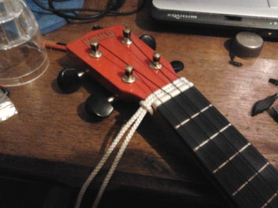 Fit Guitar Strap End Pin Buttons and Gutar Style Strap to a Ukelele.