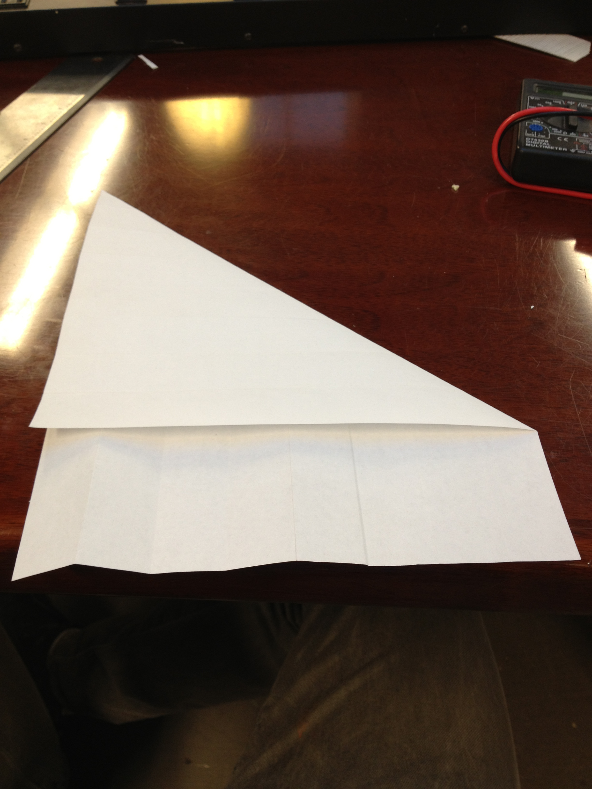 "Picture of Folding the Paper to Make ""guide Lines"" for Drawing"