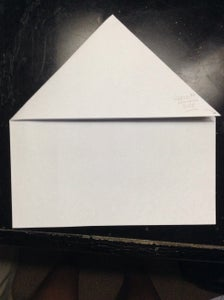Then Fold the Top Left Corner and Put It to the Opposite Side Downward Forming a Triangle