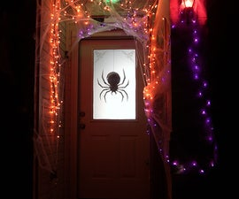 Halloween: cheap and easy dropping spider silhouette