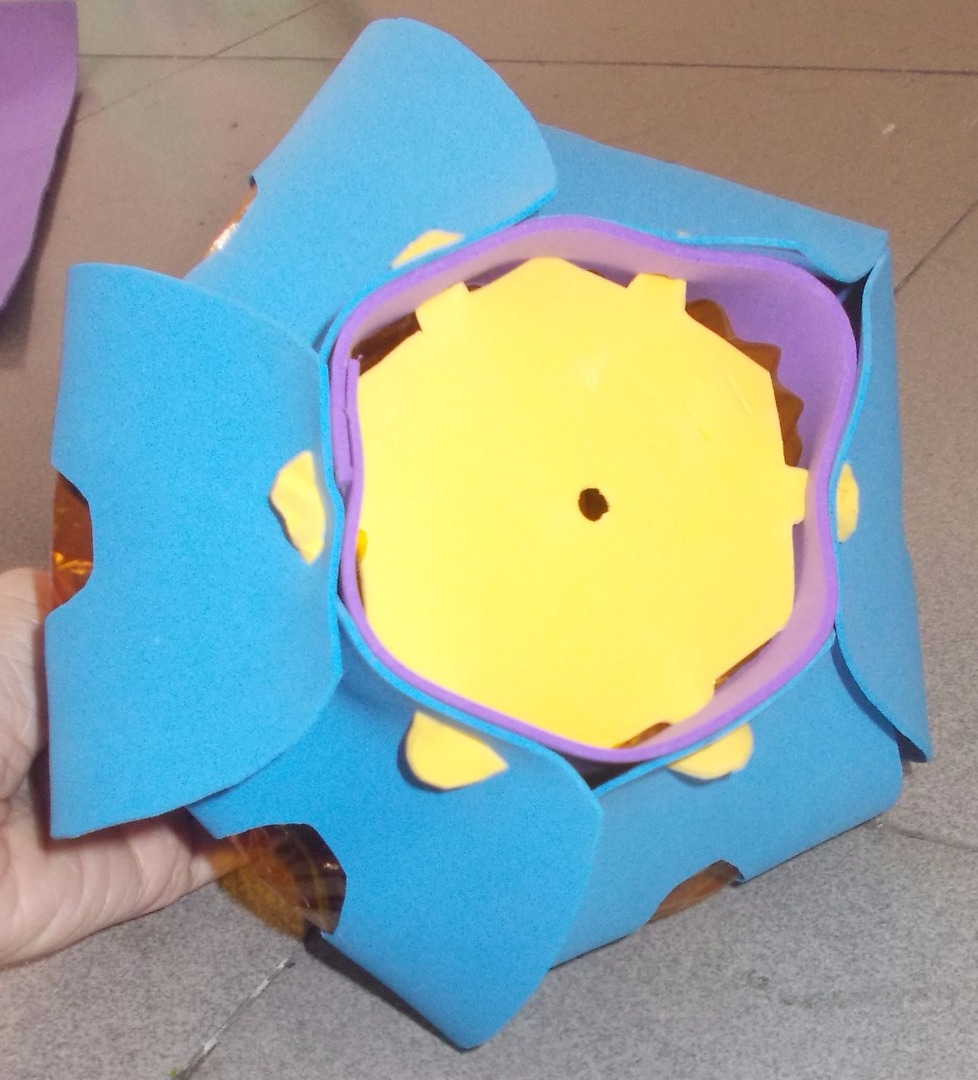 Picture of Poke 6 Petals Onto the Top and the Bottom of the Lantern.