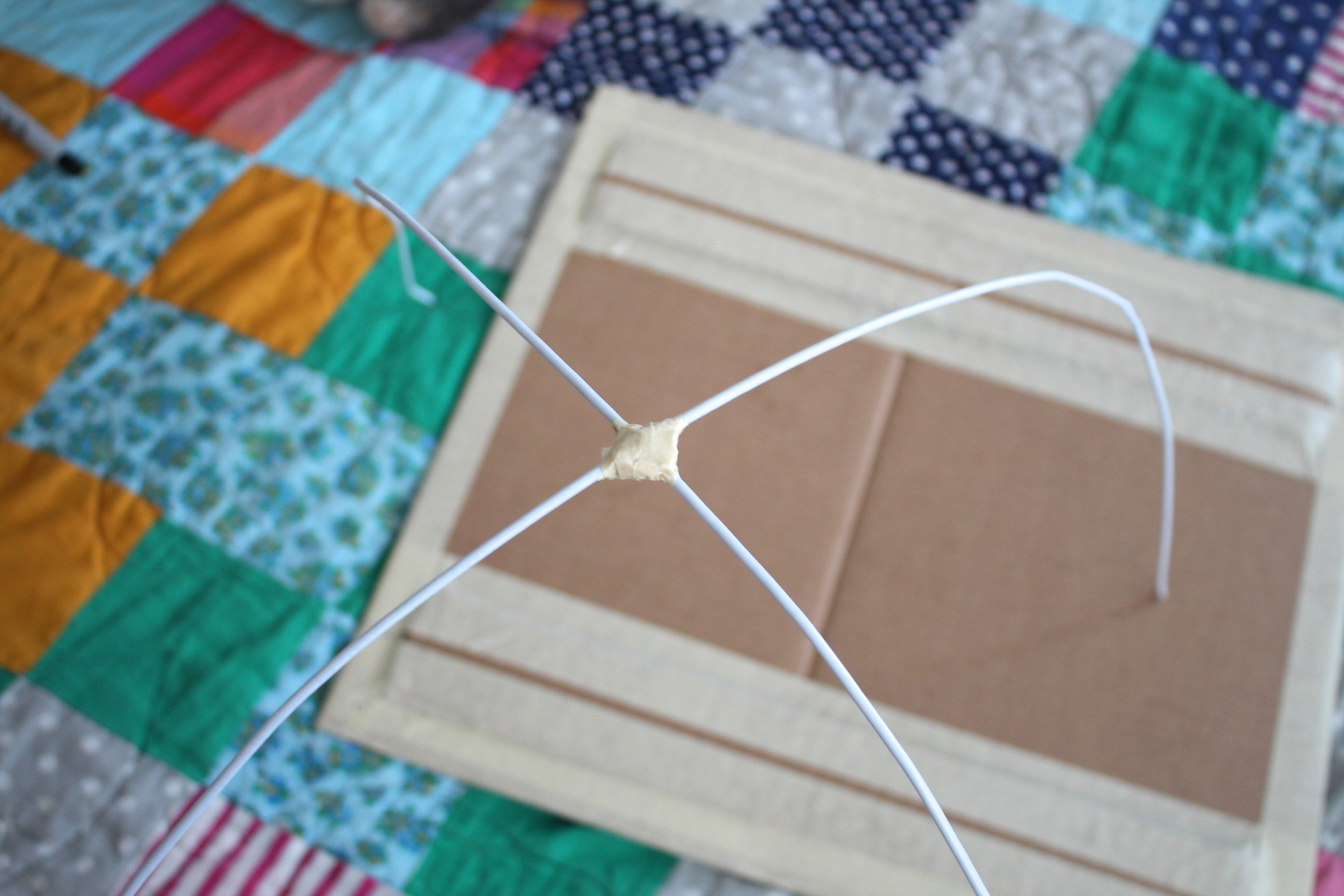 Picture of Tape the Two Hangers Together