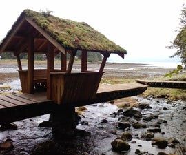 A cantilevered foot bridge out of logs - with a hut!