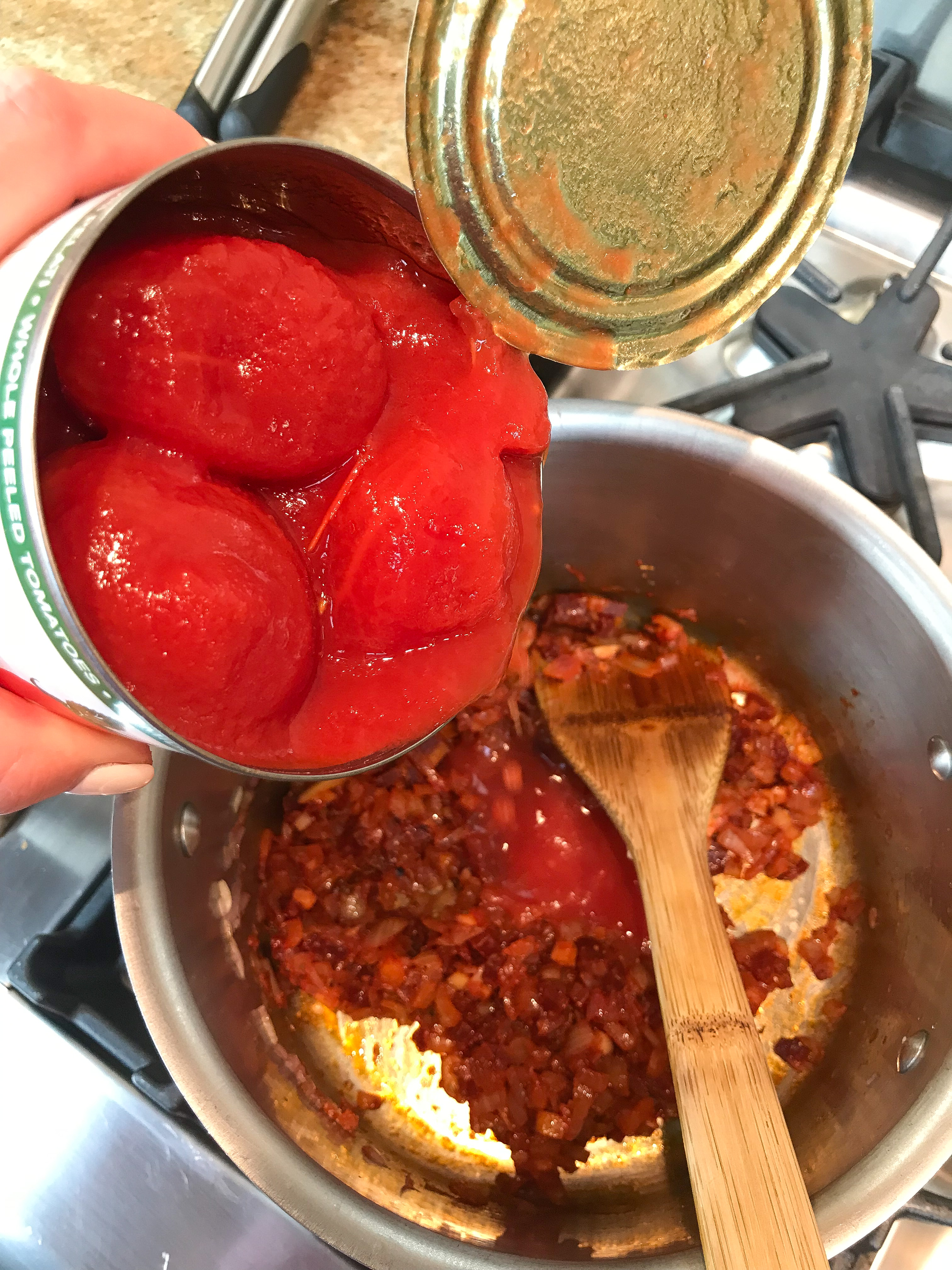 Picture of Add Tomatoes and Simmer the Sauce