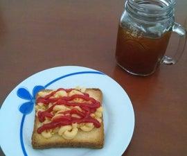 Fusión de pan tostado y macarrones con queso.