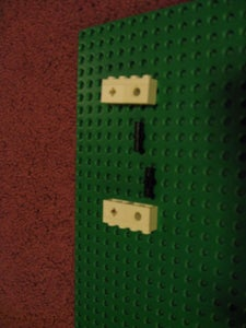 Connect the 1x4 Plate Onto the 1x2 Bricks in the Order Shown.