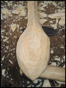 Cut the Rougt Shape of the Spoon With the Axe.