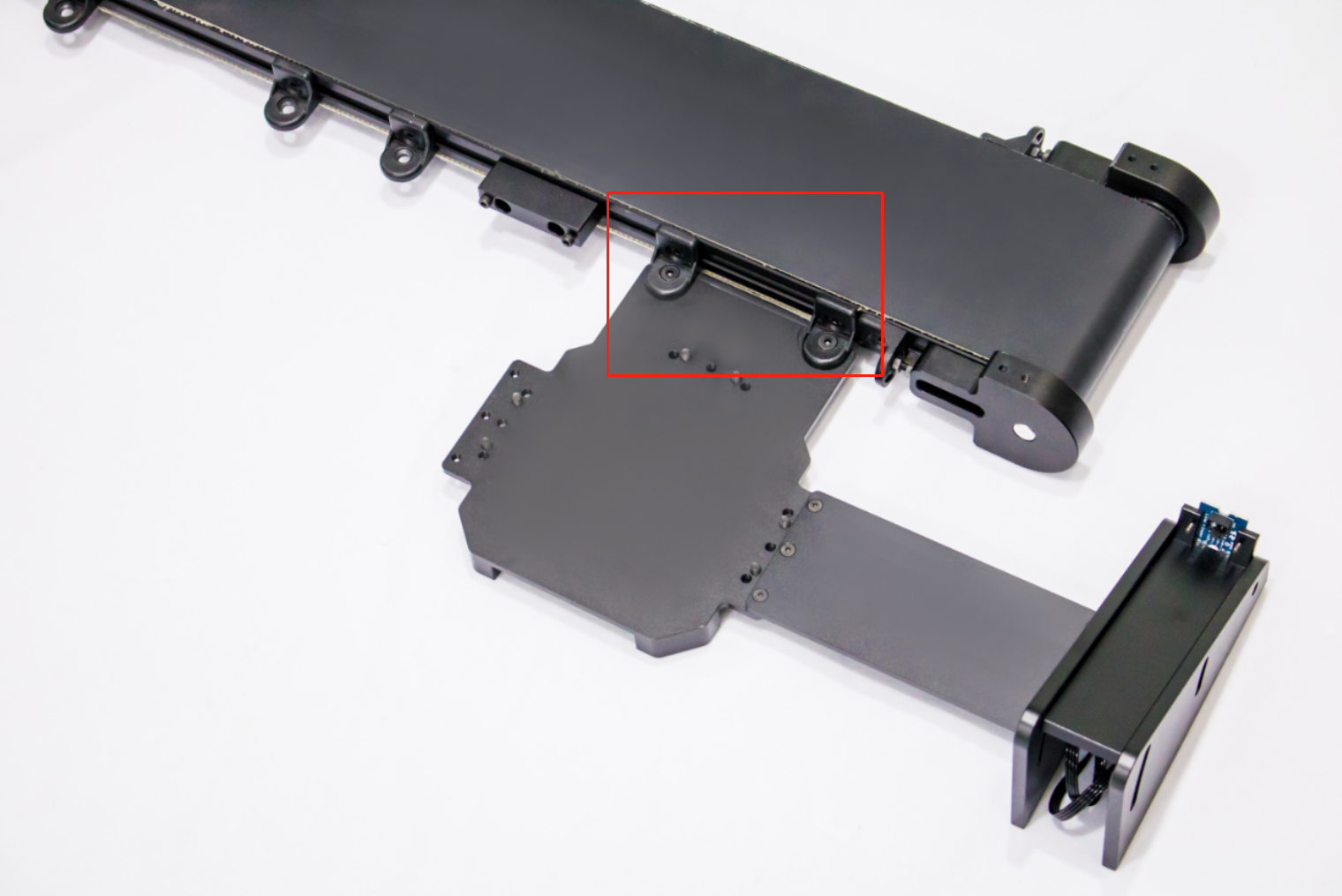 Picture of Install the UArm Stator (with Material Slide): Fix the UArm Stator on the Conveyor Belt