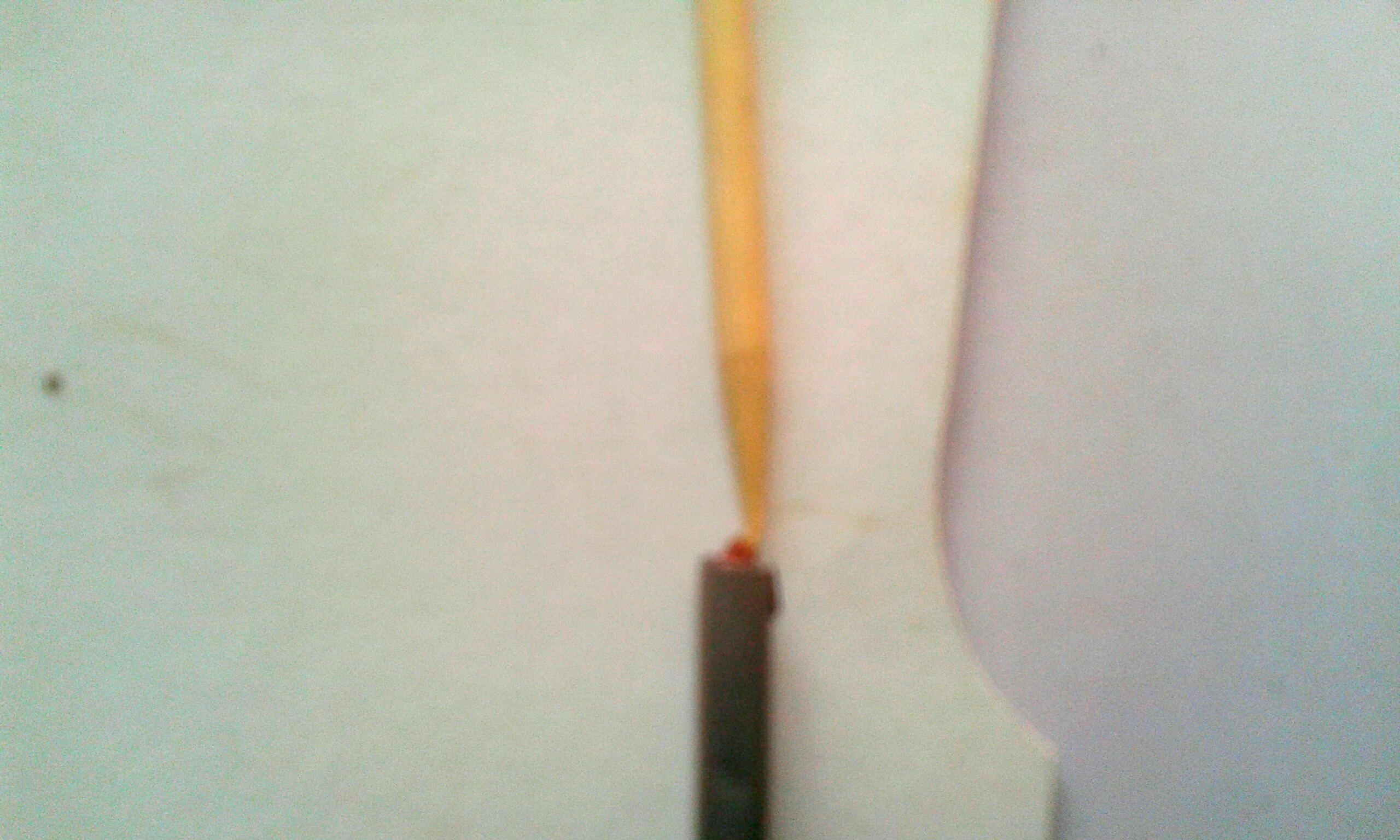 Picture of Push a Match Head Into the Foil Tube