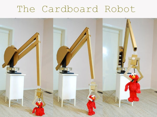 Giant Computer-Controlled Robotic Arm Made of Old Cardboard Boxes