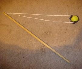 hand operated trebuchet/tennis ball hurler/staff sling