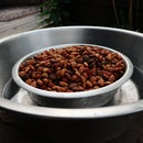 combine dog food and water bowl to defend against ants. Keeping ants out of dog food.