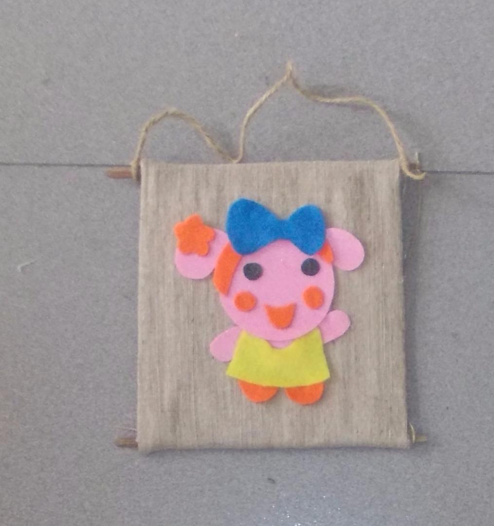 Picture of Glue Miss La Sen Felt Doll Onto the Burlap Curtain.