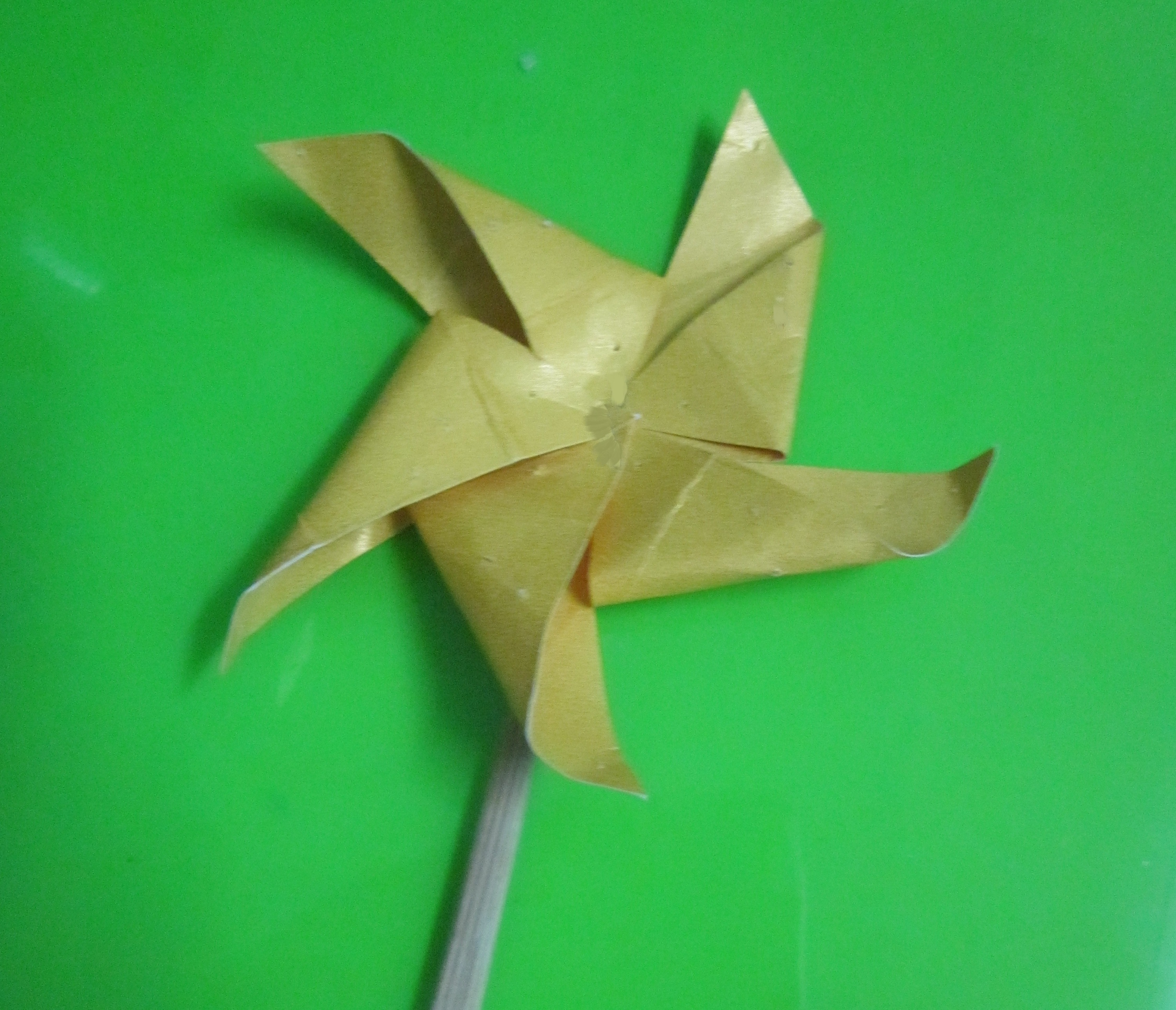 Picture of Fold It Like the Picture and Insert the Bamboo Bar Into the Pinwheel