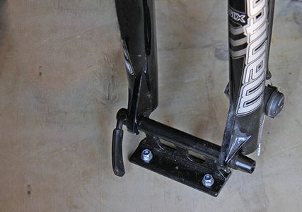 Attach a Fork Mount to One Bike's Front Fork.