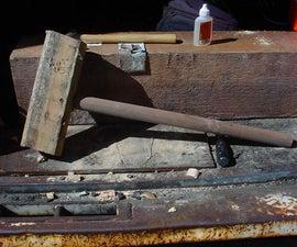 A wooden persuader (hammer)