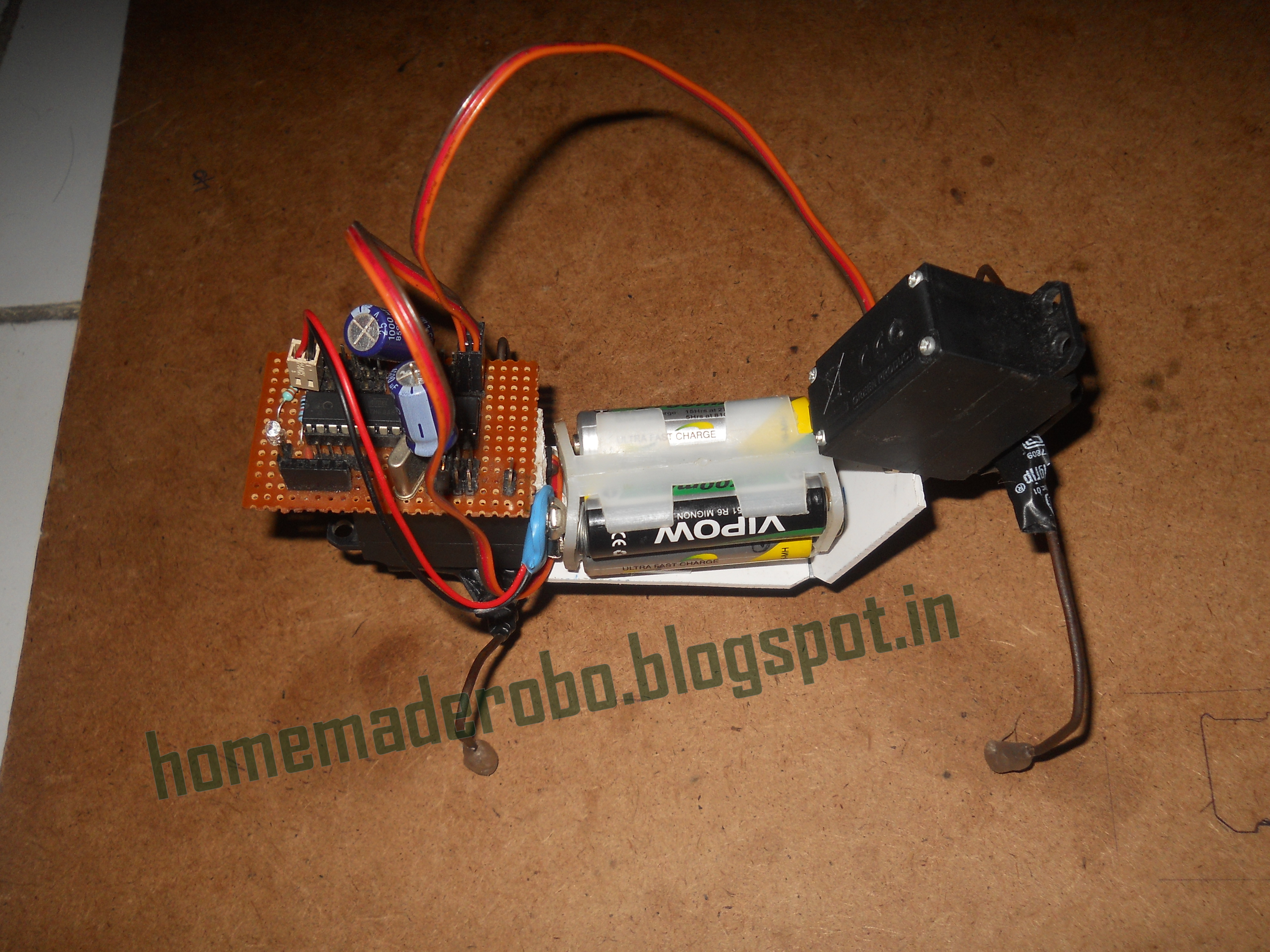 Picture of Quadruped Robot Using 2 Servos With Home Made Arduino