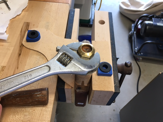 Picture of Measuring the Compression Nut Diameter and Depth and Marking on the Spindle, Turning for the Nut to Be Threaded On.