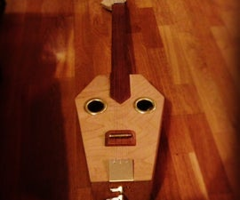 electro acoustic coffin slide guitar