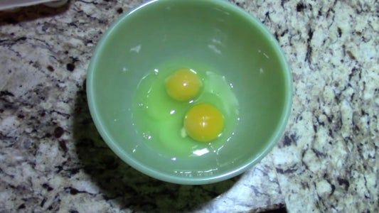 Crack Two Eggs Into Mixing Bowl
