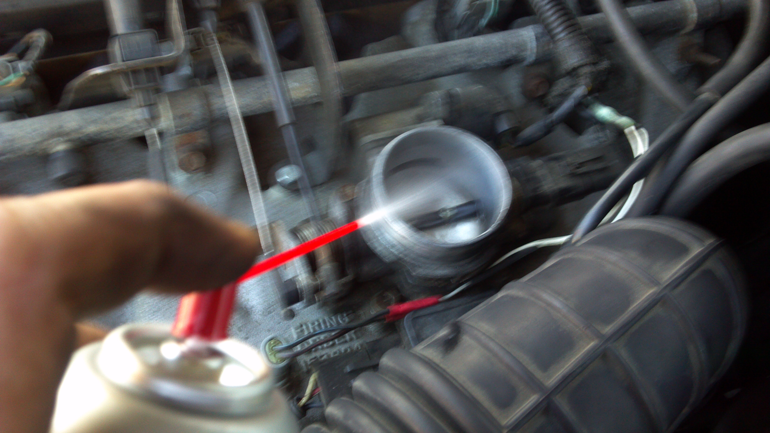 Picture of Spray Out the Throttle Body