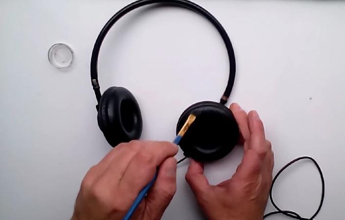 Picture of We Take Our Oil Paint for the Face and Apply With a Brush Inside the Earmuff Headset.