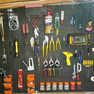 Keeping Pegboard Hooks From Falling Out When Removing Tools