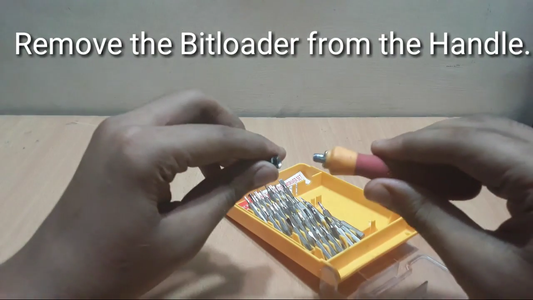 Remove the Bitloader(Where You Put the Screw In) From the Handle of the Screwdriver & Fix It on the Shaft of the Motor With the Help Epoxy Putty!