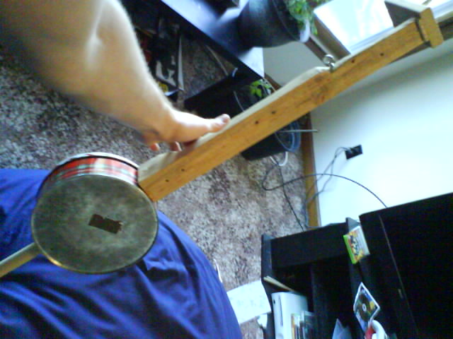 Picture of A Cookie-tin Banjo in 14 Steps or Less
