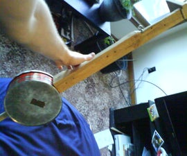 a cookie-tin banjo in 14 steps or less