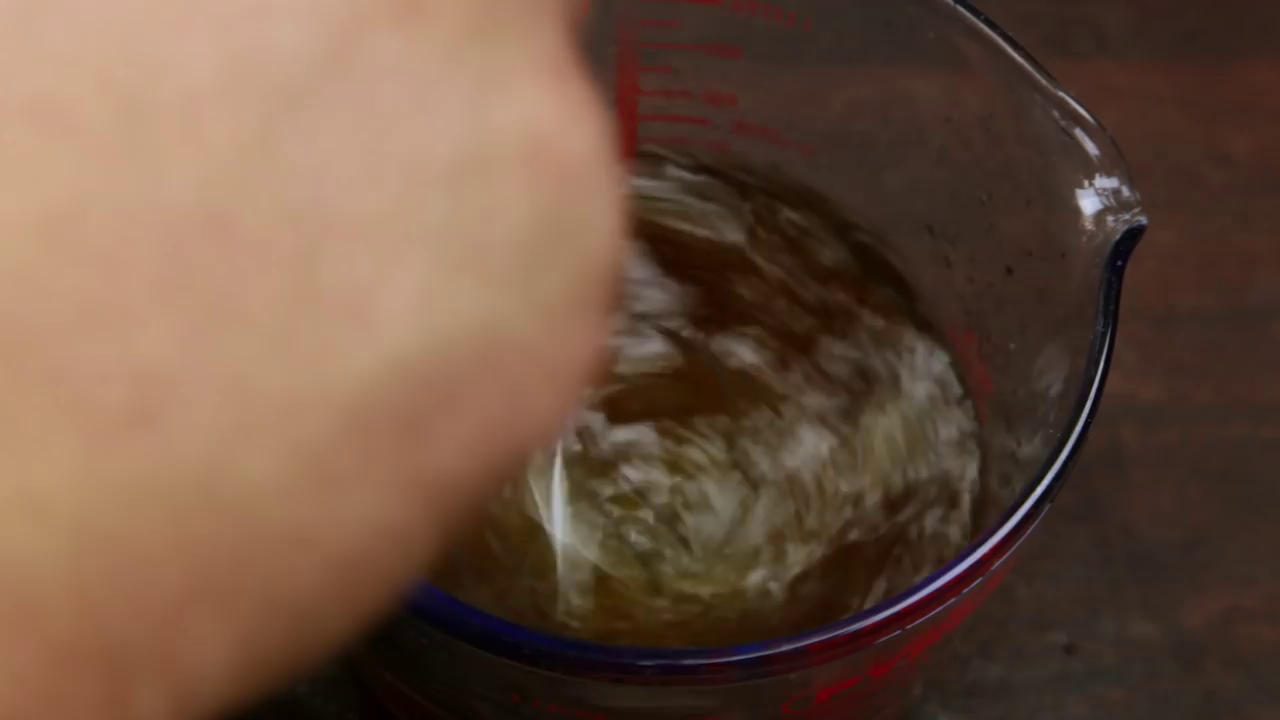 Picture of Using a Strainer, Pour the Water That Has Now Been Flavoured With the Garlic Into the Bowl.