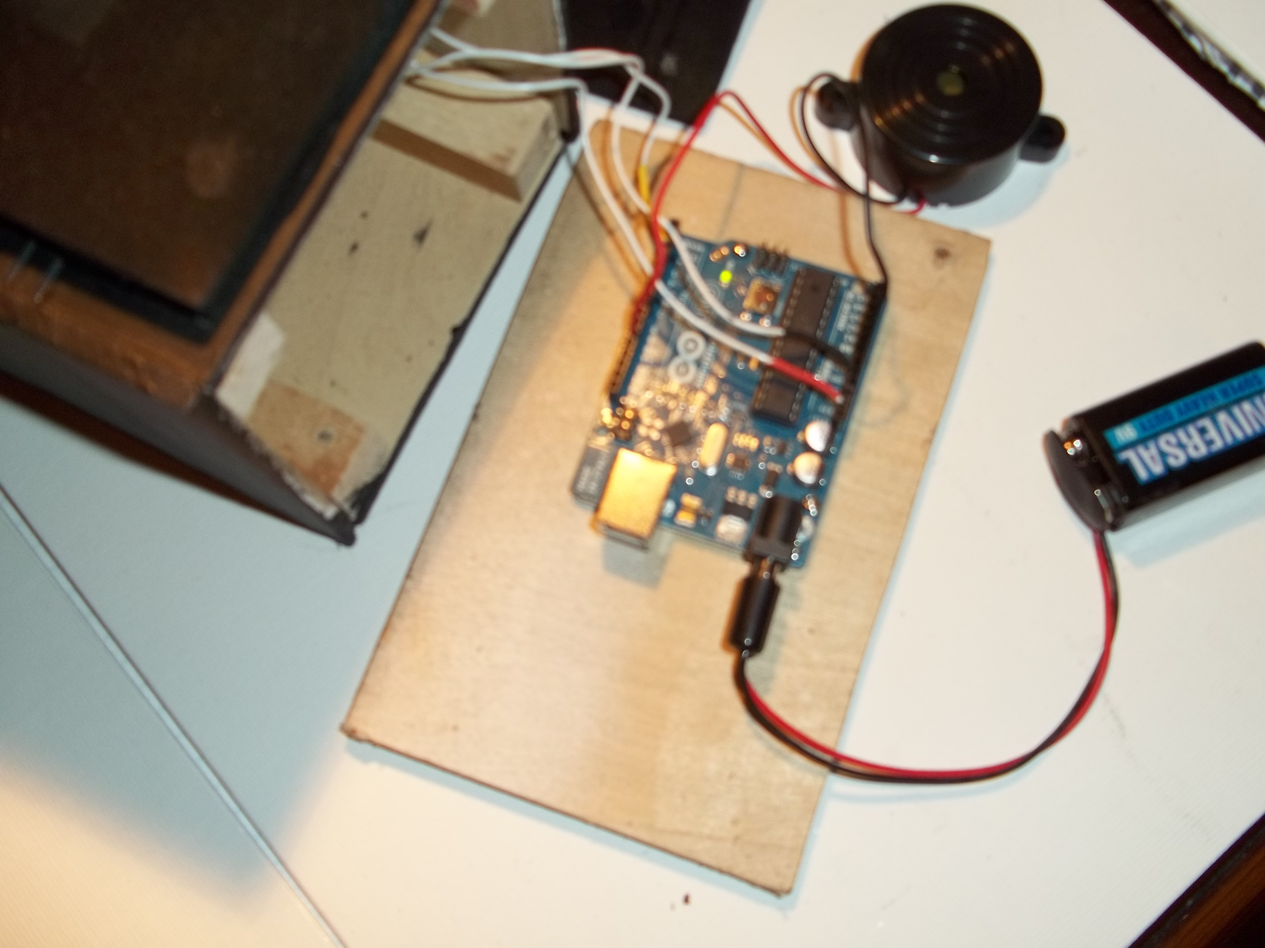 Picture of Secure the Arduino and Attach the PIR: