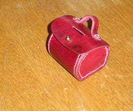 "Leather ""portmanteau"" bank/ coin purse"