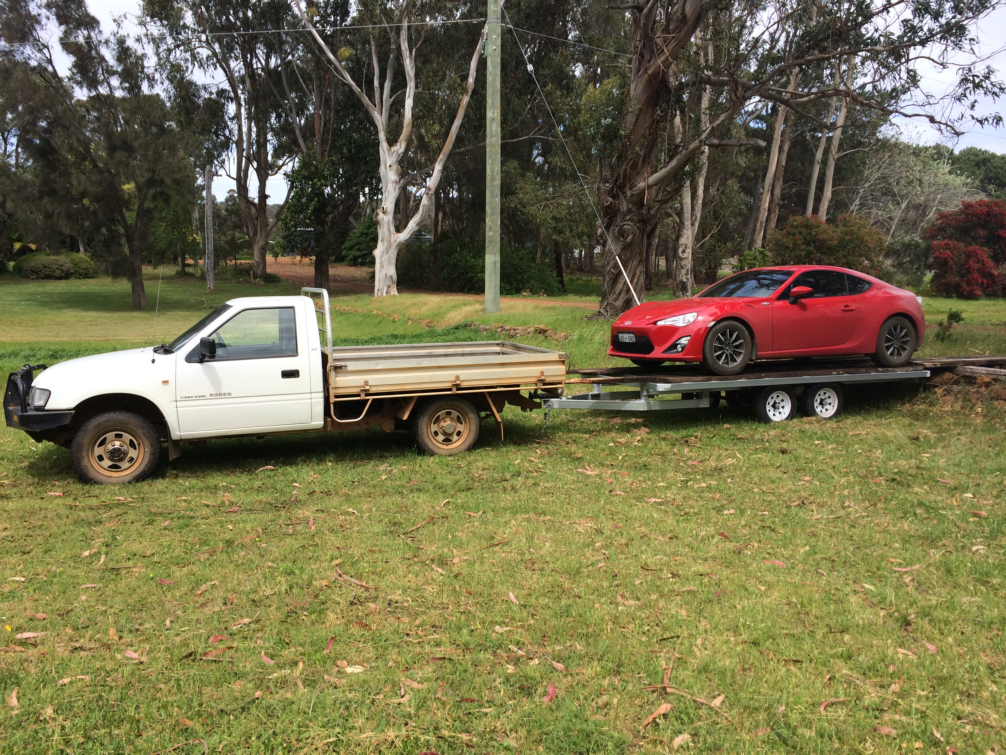 Picture of Three Trailers in One - Box, Car and Flat Top.   the Box Top Trailer.