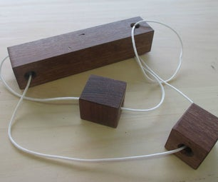 Wooden Cube and String Puzzle