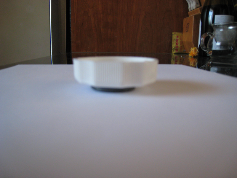 Picture of Place the Cap With the Saltwater/pepper Mixture on the Magnet