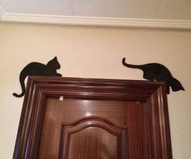 silueta gato con tablerillo