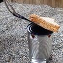 Estufa de una lata para camping