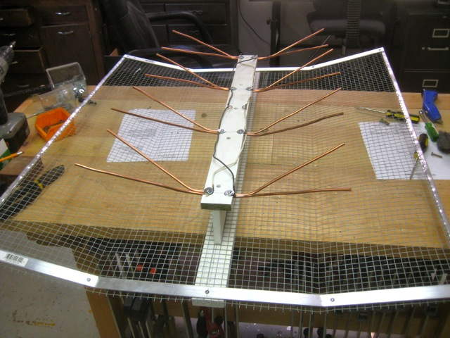 Picture of Mounting the Whisker Spline to the Reflector