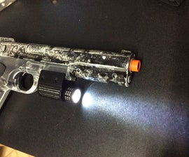 Airsoft spring pistol flashlight mod