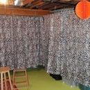 Cheap, stylish junk storage camouflage.