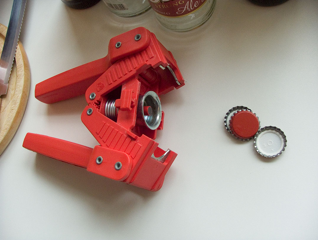 Picture of You Will Need a Gadget Like This to Put the Bottle Tops On