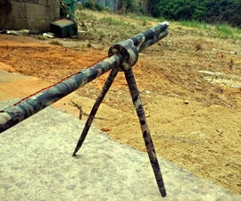 Laser-assisted takedown blowgun with bipod