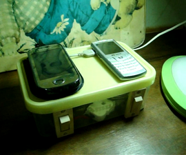 Mini Cellphone charging station using recycled ice-cream box or any box & recycled electrical parts.