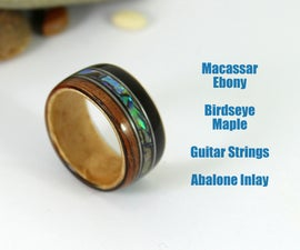 Bent Wood Ring With Guitar Strings and Abalone Inlays