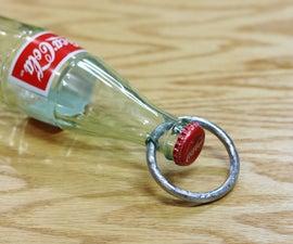 Impossible Metal Ring Through Coke Bottle