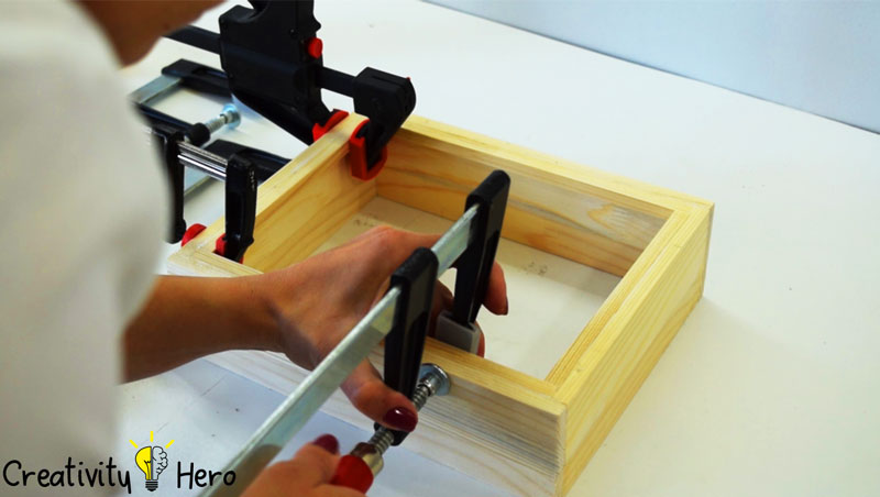 Picture of Build a Frame Inside the Box to Keep the Glass Panel in Place.
