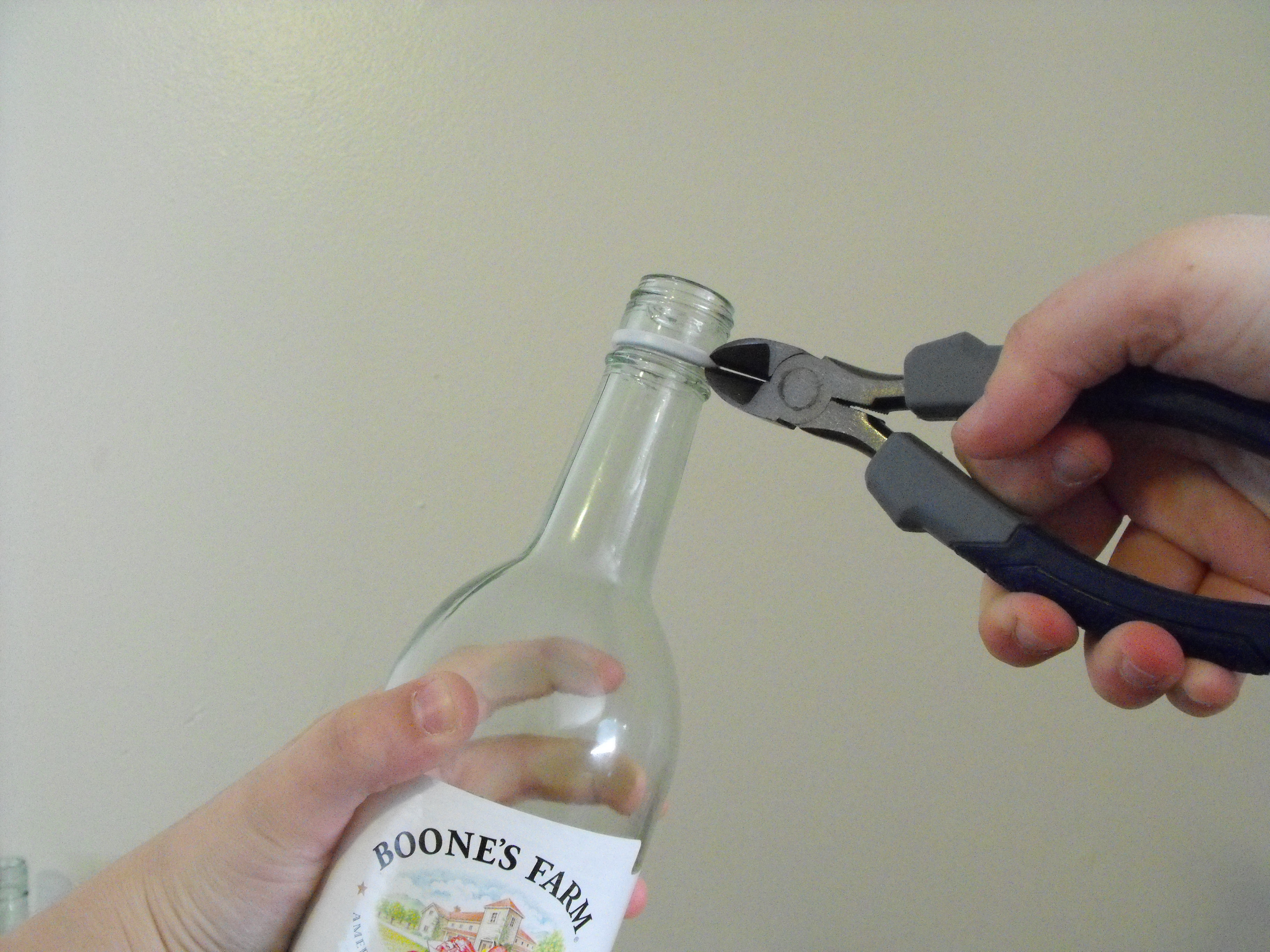 Picture of Rinse the Bottles and Snip the Rings Off