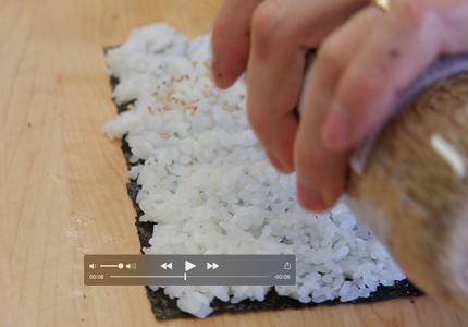 Cut Nori Wrapper in Half and Put Rice