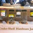 Workbench under-shelf jar storage